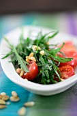 Rocket salad with tomatoes and pine nuts