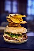 Cheeseburger with potato crisps in a restaurant