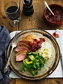 Pan-fried duck breast with savoy cabbage, mashed potatoes and lingonberry jam