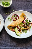 Crepe with pickled carrots and avocado
