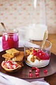 Yoghurt with cookies and pomegranate seeds