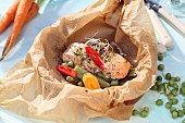 Salmon with vegetables in parchment paper