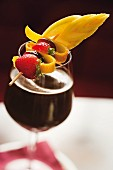 Cold chocolates garnished with a fruit skewer at Caffe degli Specchi, Triest, Italy