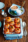 Stuffed tomatoes with rice, lentils, feta cheese and mint
