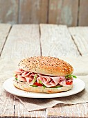 A ham sandwich on a plate
