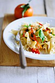 Pasta with mandarin oil, peppers and basil
