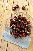 Fresh cherries in a wire basket