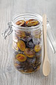 Sweet-and-sour preserved damsons in a jar
