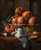 Persimmons in a fruit bowl
