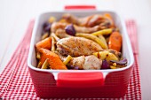 Oven-baked chicken legs with root vegetables and yellow beans