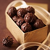 Truffle pralines in a golden box