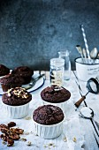 Gluten-free chocolate muffins with pecan nuts