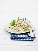 Farfalle salad with ham, apples and onions