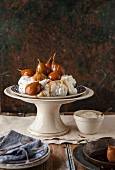 Pavlova with poached pears