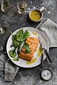 Poached salmon fillets with spinach and green asparagus (seen from above)