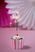 A Valentine's Day cupcake with a sparkler