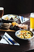 Various dishes and a glass of beer on the table