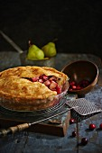 Autumnal fruit pie with pears and cranberries