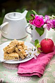 Apple pie on a plate with apple blossoms