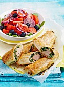 Mediterranean sausage rolls with tomato and olive salad
