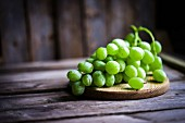 Green grapes on a rustic wooden surface