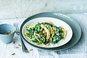 Spaghetti with spinach, gorgonzola cheese and pine nuts