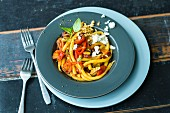 Pepper and walnut pasta with feta cheese