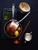 Stillleben mit Kupferkasserolle und Zitronen
