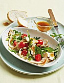 Smoked chicken salad with tomatoes and rocket