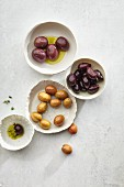 Various types of olives and bowls