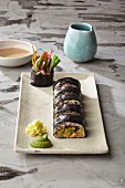 Courgette sushi in nori sheets with coconut and hoisin sauce and Thai basil