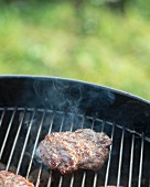 A hamburger on a barbecue