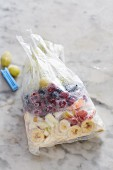 Frozen fruits in a freezer bag for making smoothies