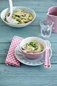 Chicken fricassee in creamy leek with peas