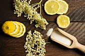 Ingredients for elderflower syrup: elderflowers, sugar and lemons