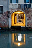 An illuminated alleyway in the Cannaregio quarter, Venice, Italy
