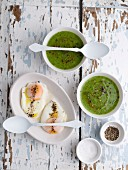 Watercress soup and poached eggs with pepper