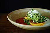 Arepas (cornbread) with guacamole and tomato sauce (Latin America)