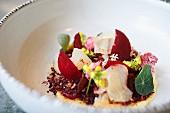 Crudo salad with hamachi, beetroot, grapefruit and flowers