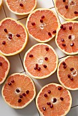 Grapefruit halves with pomegranate seeds (seen from above)