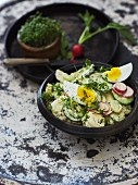Potato salad with hard-boiled eggs and fresh cress