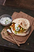 Pita bread filled with a mirepoix salad a feta cheese cream