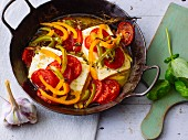 Gratinated sheep's cheese with colourful peppers