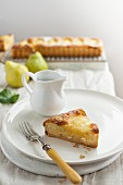 A slice of pear and almond tart