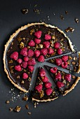 Chocolate tart with raspberries and nuts