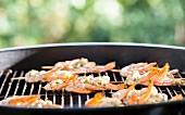 Prawn skewers on barbecue