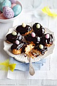 Mini eclairs with whipped cream and chocolate glaze for Easter