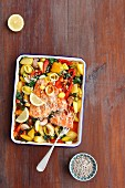 Salmon bake with potatoes, leeks, spinach and peppers