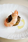 Sparnocchi con lardo di Colonnata e farinata di cavolo nero (a prawn canapé with lardo and black kale, Italy)