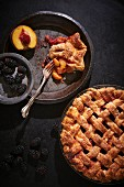 Peach and berry pie with blackberries, raspberries and apricot jam